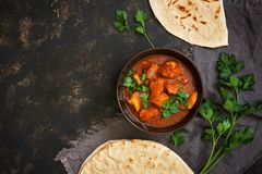 Hot spicy chicken tikka masala in bowl.A popular Indian spicy dish. Top view, close-up. royalty free stock photos