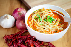 Hot and spicy curry noodle on the table Stock Photos