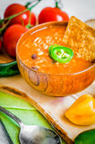Hot and spicy fresh made Mexican chili soup on rustic background Royalty Free Stock Images