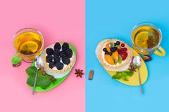 Hot spicy lemon tea served with fruit tarts stock photography