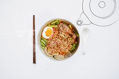 Hot and Spicy noodle in bowl and ingredients on isolated white background, Korea noodles with boil eggs in bowl with spoon and cho. Psticks royalty free stock image