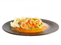 Hot and spicy papaya salad Stock Photos
