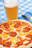 Hot spicy pizza and beer Royalty Free Stock Photography