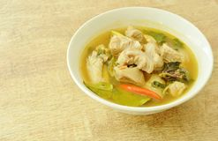 Hot and spicy pork bone with tamarind and Thai herbs soup on bowl. Hot and spicy pork bone with tamarind and Thai herbs soup on white bowl royalty free stock image