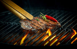 Hot spicy rump steak on a summer barbecue Royalty Free Stock Images