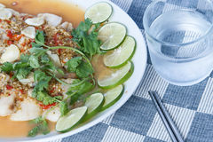 Hot and spicy slice fish, thai style. Hot and spicy slice fish thai style with a glass of drink water Royalty Free Stock Photos
