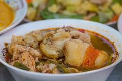 Hot and spicy soup pork cartilage. With Thai herb Stock Images