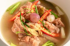 Hot and spicy soup with pork ribs in white cup . stock image