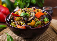 Hot spicy stew eggplant, sweet pepper, olives and capers. Royalty Free Stock Photos