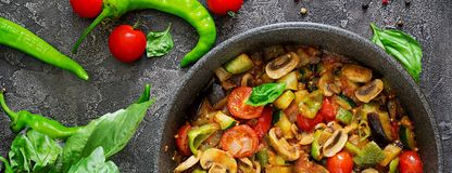 Hot spicy stew eggplant, sweet pepper, tomato, zucchini and mush stock images