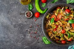 Hot spicy stew eggplant, sweet pepper, tomato, zucchini and mushrooms. royalty free stock images