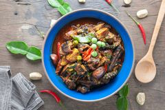 Hot and spicy stir - fried ell in bowl on old rustic wooden table. Hot and spicy stir - fried ell in bowl on old rustic wooden table, Thai food royalty free stock image