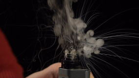 Hot spiral in the e-cigarette stock video footage