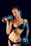 Hot sports girl woth dumbbells looking at camera Royalty Free Stock Images