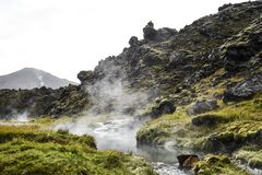 Hot spring with beautiful vegetation in the Icelandic mountains. Stock Image