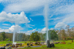 Hot spring fountain with blue sky. Hot spring fountain at Sankampaeng hot springs at San Kampang district, Chiang Mai , Thailand stock photography