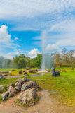 Hot spring fountain with blue sky. Hot spring fountain at Sankampaeng hot springs at San Kampang district, Chiang Mai , Thailand stock photos