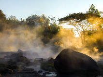 Hot spring. Morning is beautiful gold steam hot spring with sunlight at Jae Son National Park,Thailand Stock Image