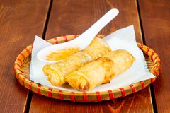 Hot spring roll. With sauce stock images
