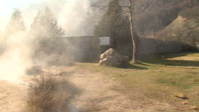 Hot spring and a stone cross in the Rupite, Bulgaria stock video