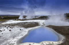 Hot Spring and Strokkur Geyser Iceland Stock Images