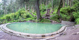 Hot spring in to Peguche waterfall Royalty Free Stock Images