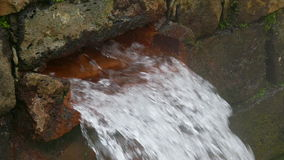 Hot Spring Water Flow from Pipe on Wall stock video footage