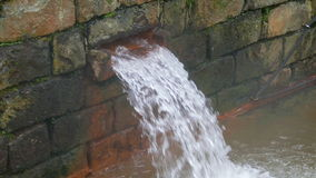 Hot Spring Water Flow from Pipe on Wall stock video