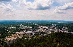 Hot Springs Arkansas Tower Overlook Summer Days. Ozark mountains surround the town and you can see the entire horizon of the earth over the city. partly cloudy royalty free stock photos