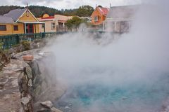 Hot Springs in the centre of Maori village in Rotorua in New Zealand. Traditional indigeneous settlement of New Zealand royalty free stock photo