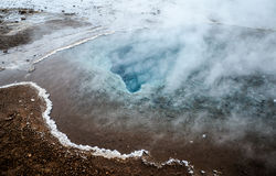 Hot Springs, Golden Circle, Iceland. Colorful soil and steaming hot springs of Strokkur Geyser Royalty Free Stock Photo