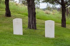 Hot Springs, South Dakota National Cemetery. HOT SPRINGS, SOUTH DAKOTA - June 8, 2014: Two graves off to the side with the same death date and no record of stock photography
