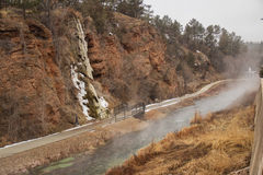 Hot Springs South Dakota. Steam rising off a stream beside a cliff Royalty Free Stock Images