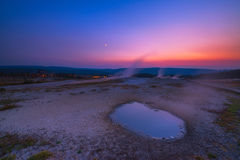 Hot springs sunset at Yellow Stone National Park. Steam rising from hot springs at Yellow Stone National Park during a colorful sunset Royalty Free Stock Image