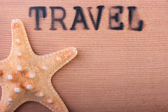 Hot stamping Travel. The wooden panel with a hot stamping Travel with a starfish Stock Image