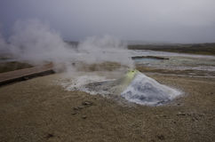 Hot steam coming from the boiling water in the central Iceland i Stock Images