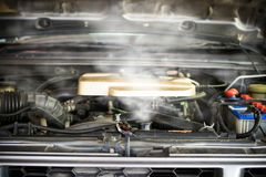 Hot steam coming out of Radiator, Car engine over heat.  stock images