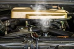 Hot steam coming out of Radiator, Car engine over heat.  royalty free stock images