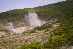 Hot Steam by Geothermal. Hakone, Japan. The smelly hot steam is coming from underground thermal springs Royalty Free Stock Photos