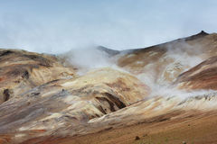 Hot steam raising above colored hills at Hverarond area, Iceland Royalty Free Stock Photo