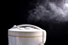 Hot steam and smoke floating beautiful rice cookers. stock photography