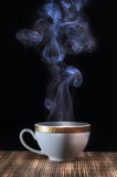 Hot steaming coffee Stock Images