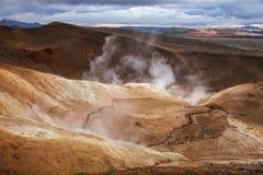 Steaming fumarole on rhyolite formation Krafla volcanic area Myvatn region Northeastern Iceland Scandinavia. Hot steaming geothermal vent or fumarole on rhyolite stock image