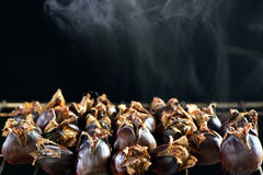 Hot steaming roasted sweet chestnut Stock Photo