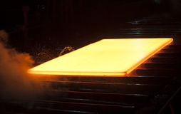 Hot steel. A piece of hot steel on conveyor royalty free stock photos