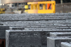 Hot steel bars from casting plant. Royalty Free Stock Photography