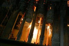 Hot steel in continuous casting machine. stock photo