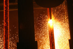 Hot steel in continuous casting machine. Royalty Free Stock Photos