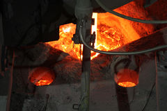 Hot steel in continuous casting plant. Hot steel in continuous casting plant showing liquid steel and coating royalty free stock images