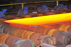 Hot steel on conveyor Stock Photography